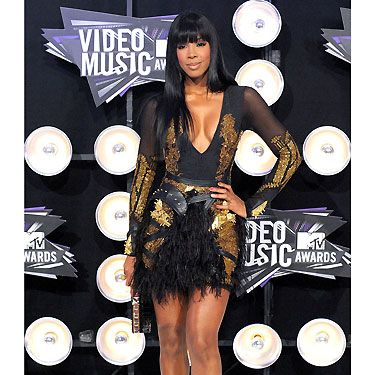Kelly Rowland donned this gorgeous Falguni & Shane Peacock dress for the 2011 MTV Video Music Awards. The gold embroidered dress complete with feather and leather detailing brings out the sexy, confident Kelly we know and love!