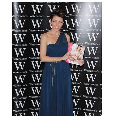 The evening of the floral dress disaster, Dannii has certainly upped the style stakes. This navy draped dress work at her book launch for Waterstone's, looks amazing on her, and she looks super confident!  Dannii has certainly experimented with fashion throughout the years, and we reckon she's found her unique style