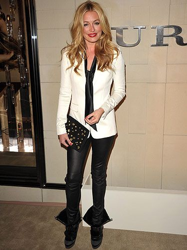 Cat Deeley looked sensational in her monochrome ensemble. Her red lips, red nails and studded clutch looked divine against the black and white backdrop of her outfit