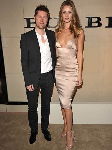 Burberry Chief Creative Officer Christopher Bailey and the foxy Rosie Huntington-Whiteley hosted a cocktail party to celebrate the launch of Burberry Body in Beverly Hills, and don't the pair of them look swish?