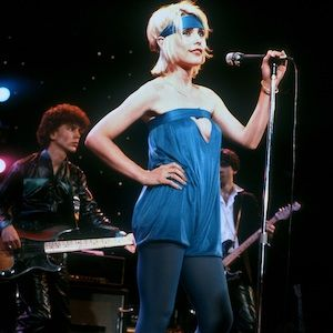 Debbie has always been courageous with her style&#x3B; this utterly bold blue hue looks absolutely amazing on the young <en>Blondie</em> singer! From the headband and the all-over colour, right up to the daring cut-out detail, everything about this look suggests that Debbie is utterly confident in her unique ensemble... and so she should be. She looks BRILLIANT!