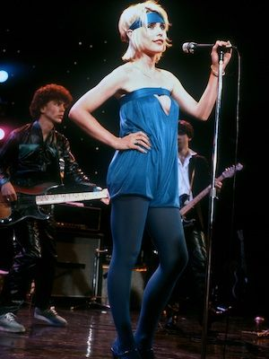 Debbie has always been courageous with her style; this utterly bold blue hue looks absolutely amazing on the young <en>Blondie</em> singer! From the headband and the all-over colour, right up to the daring cut-out detail, everything about this look suggests that Debbie is utterly confident in her unique ensemble... and so she should be. She looks BRILLIANT!