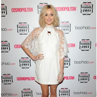 The first of Fearne's outfits for the evening was this fab white lace frock by Aqua Couture. She teamed the floaty number with shoes by Larah Bohinc