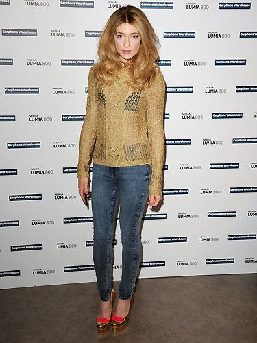 Girls' Aloud star Nicola Roberts played a secret gig for fans at a Carphone Warehouse store to promote the new Nokia Lumia handset - lucky fans! Here she poses wearing a cute golden jumper - and is that a hint of bra-action peeping out from underneath? A bit risqué, but we like it!