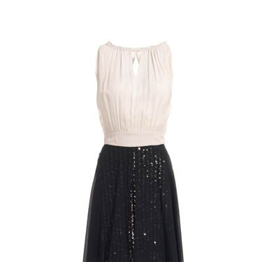 """<p>Sophisticated sequins are just as impressive as the bold statement dresses. This look from Reiss is elegant and regal, and perfect teamed with vintage jewellery</p><p>£225, <a href=""""http://www.reissonline.com/shop/womens/dresses/party_dresses/kamille/black/#"""">Reiss</a></p>"""