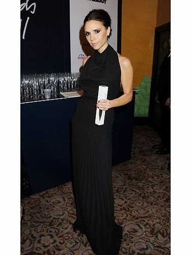 Here's VB clutching her award and what a triumph - the Designer Brand Award. Twitter went into overdrive with talks of Posh's tears. We admit, we love a little celeb sob, but not to the extent of Gwyneth Paltrow and her Oscar speech - too much! Luckily VB wept in style