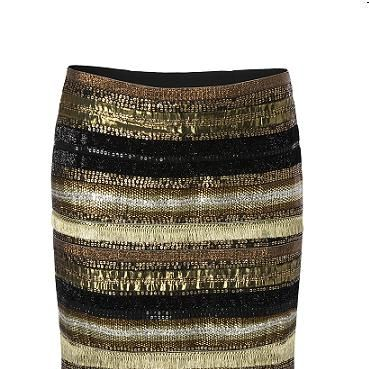"""<p>Strike gold with this treasured mini skirt – it deserves pride of place in your wardrobe. Fierce, Egypt-inspired, and with a metallic edge to set winter on fire</p><p>£89, <a href=""""http://shop.mango.com/GB/p/mango/clothing/skirts/mini-skirt/?id=53308925_94"""">Mango</a></p>"""