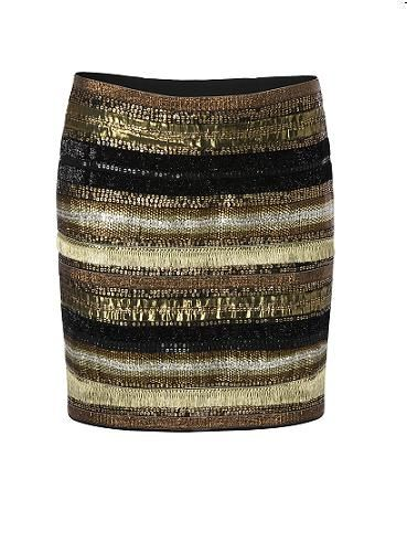 """<p>Strike gold with this treasured mini skirt – it deserves pride of place in your wardrobe. Fierce, Egypt-inspired, and with a metallic edge to set winter on fire</p> <p>£89, <a href=""""http://shop.mango.com/GB/p/mango/clothing/skirts/mini-skirt/?id=53308925_94"""">Mango</a></p>"""