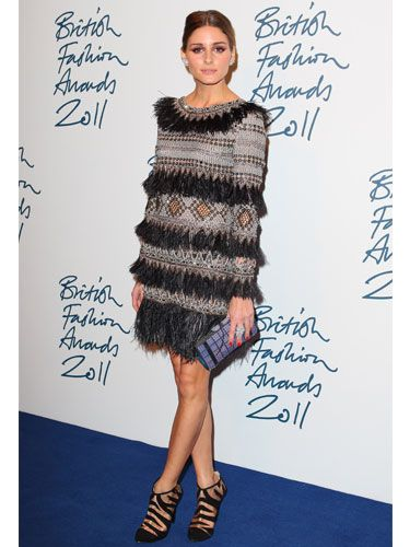 <p>Designer styles were expected all round at this year's British Fashion Awards in London, and while Olivia hit the ceremony in a fabulous fringe and bead embellished dress by Matthew Williamson, she decided to team it with a high street steal: a fierce pair of tiger stripe heels from Topshop. Grr-eat! </p>