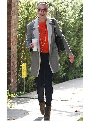 Orange is our one of our favourite shades right now – not only is it it versatile, it also cheers up the dullest of days. Katherine teamed her bright orange top with skinny jeans, big shades and a grey blazer. Civvie chic