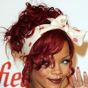 Rihanna IS the hair chameleon - one minute her hair is bobbed, then cropped, then out of nowhere - bright red! Rihanna can do no wrong in the hair stakes, and her red curly do was a hit in 2011