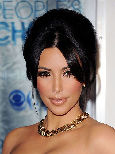 Kim Kardashian ALWAYS has super-perfect hair! Whether she wears her locks sleek and straight, or swept up into a tousled updo as pictured, Kim's hair  means multi-millionaire business