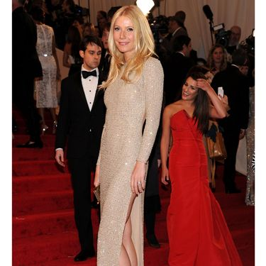 Being besties with Stella McCartney – and her personal trainer! – definitely paid off for Gwyneth Paltrow! The actress looked amazing in a shimmering, nude Stella McCartney gown and satin heels at this year's Met Ball Gala