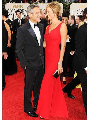 George Clooney arrived with his sexy lady in red, Stacy Kiebler. They were one of the first couples to arrive on the red carpet at the Golden Globes. She looked divine in her stunning red Valentino gown with its red bow detail on the back. And he, well he's George Clooney, he always looks gorgeous