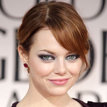 Emma Stone went for a smoky eye and a light pink hue for the lip at the Golden Globe Awards. Her hair was swept loosely up, to show off her gorgeous feline eyes we suspect