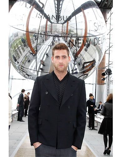 Oliver Jackson-Cohen struck the coolest pose at Louis Vuitton's menswear show in Paris. We might need to ask his fashion designer mum Betty Jackson if she'll let us take Oliver's hand in marriage - he's just TOO hot!