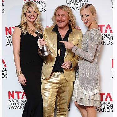Hurrah! Keith and his pals Fearne and Holly celebrate their big win at the NTAs. Forget the girls Keith, we're loving the gold lame