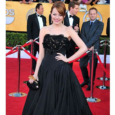 Emma Stone looked fantastic in Alexander McQueen at the SAG Awards. All eyes were on girl-of-the-moment, Ms Stone and what she would wear on the red carpet, she had no reason to worry though, she nailed it! We especially loved her jewellery which included a gold knuckle-duster also by McQueen and a pair of super-spangly earrings by Tiffany & Co.