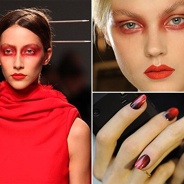 <p>Leave it to MAC makeup expert Alex Box to properly sweep on a red metallic eyeshadow on the models at the Gareth Pugh show. With absolutely no eyeliner or mascara, this was matched with the classic MAC Pro Red Lipmix to make a totally unique twist on the gothic vampy beauty trend.</p>