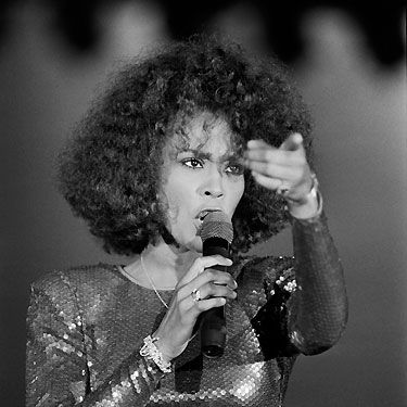 <p>Performing in Monte Carlo in 1988, Whitney dazzled in sequins as she belted out her set at the city's Sporting Club</p>