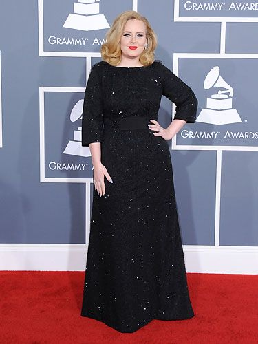 Adele looked stunning in a shimmering black Giorgio Armani gown plus retro red lips