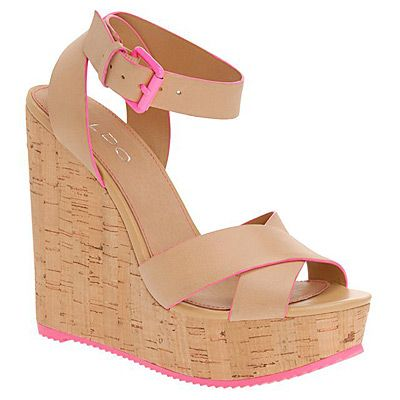"<p>Feast your eyes on these delightful cork wedges from ALDO. The flash of fluro nods to this season's sportswear trend -  without having to forfeit your heels, natch.</p> <p>Brimfield wedges, £70, <a title=""Aldo weges"" href=""http://www.aldoshoes.com/uk/women/sandals/sandals/88278073-brimfield/32"" target=""_blank"">ALDO</a></p>"