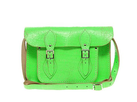 """<p>This is THE bag label of the moment: The Cambridge Satchel Company. Not only did the brand make their début on the catwalk at Basso and Brooke, but the fash pack were all sporting neon versions at London Fashion Week.</p> <p>Green Fluro Cracked Leather Satchel by The Cambridge Satchel Company, £100, <a title=""""ASOS"""" href=""""http://www.asos.com/Cambridge-Satchel-Company/Cambridge-Satchel-Company-Exclusive-to-Asos-11-Green-Fluro-Cracked-Leather-Satchel/Prod/pgeproduct.aspx?iid=1799333"""" target=""""_blank"""">Asos.com</a></p>"""