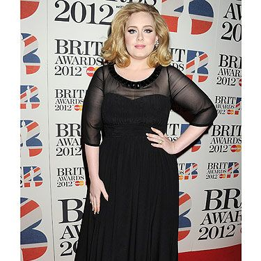 Words can't express how much we LOVE Adele, she looks absolutely gorgeous in her black Burberry frock and Van Cleef & Arpels jewels. Top points Adele!