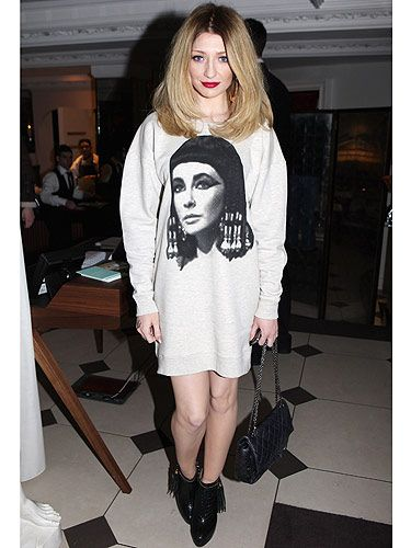 <p>Words can't express how much we love Nicola Roberts. When we hot-footed it to the Topshop NEWGEN10 London Fashion Week party we couldn't stop looking at her (yes, we know that's totally not cool!), she just looked so fab. She wore Topshop (natch!), chic ankle boots, big hooped earings - great look Nic!</p>