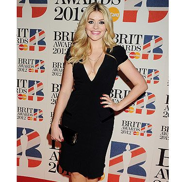 Wowsers! Holly Willoughby was the hottest lady at the 2012 BRIT Awards. A black dress can often be described as 'boring', but there is nothing boring about this look!