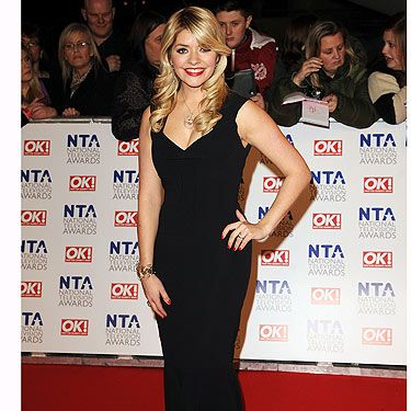 The nation's sweetheart Holly Willoughby decided on a black Roland Mouret dress for the 2012 National Television Awards, and it's a good job she did, because she looked fierce!