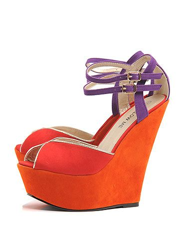 "<p>These high-rise wedges are divine; a little bit 70s and a whole lot lovely, they also tick off the colour blocking trend a treat. Want, want, WANT!</p> <p>Bright peep toe wedge, £35.99, <a title=""AX Paris"" href=""http://www.axparis.co.uk/products/-Bright-Peep-Toe-Wedge.html"" target=""_blank"">AX Paris</a></p>"