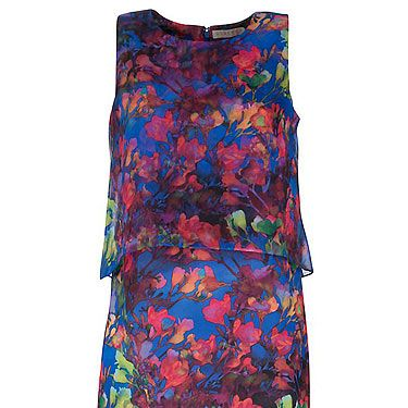 <p>This dress has got to be designer, right? Wrong! New Look are bang on the money with this floral printed frock. We also heart the cape detail to the back. We'll be wearing with colour-blocking heels and bright pink lippy. You?</p>