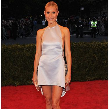 <p>Does Gwyneth Paltrow ever show signs of ageing? We can't see any. She looks smoking hot at the Met Ball Gala in her metallic Prada frock teamed with the best legs we've EVER seen</p>