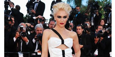 <p>Gwen Stefani went for monochrome in this peek-a-boo Armani Prive gown with bow detailing. The signer's beauty look was all about an extreme smoky eye teamed with her trademark red lippy</p>