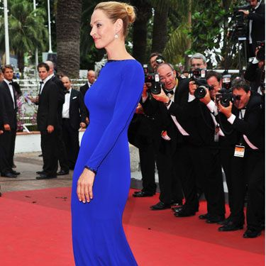 <p>Electric blue is turning out to be a popular red carpet choice right now and Uma Thurman glided her way down the Cannes red rug in this sleek gown looking positively regal. All hail queen Uma!</p>