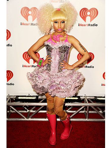 Wow. Red wellington boots, metallic leggings, lavender corset and tutu, Barbie pink bra AND a bubble perm? Nicki definitely made an impression on the red carpet when she showed up in THIS outfit...