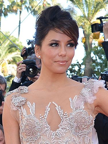 <p>With her stunning Marchesa gown doing all the talking, Eva Longoria's hair was put up in a deconstructed chignon</p>
