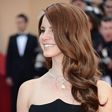 <p>Every inch the screen siren, trust Lana to give you hair envy with her fiery red mane styled in a glamorous cascade of locks</p>