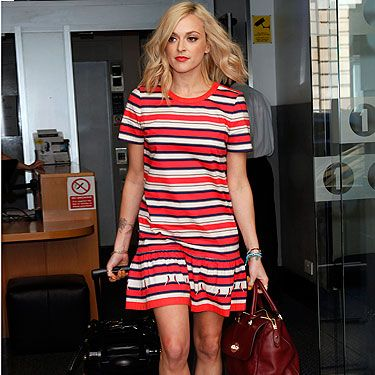<p>Fearne Cotton got her summer on in London this week, ditching her usual skinny jeans for an eye-popping striped tunic and neon pink sandals. We're loving the naughty nautical vibe she's got going on… time to steal this look for ourselves?</p>