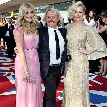 <p>Who doesn't love Celebrity Juice? We certainly do. Keith Lemon arrived with his two favourite ladies to the 2012 BAFTA Awards, looking very dapper we must say - the man scrubs up nicely! But it's not just him&#x3B; Fearne Cotton and Holly Willoughby both looked GORGEOUS! Holly is pretty in pink wearing Jenny Packham, and her BFF Fearne is lovely in vintage</p>