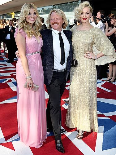 <p>Who doesn't love Celebrity Juice? We certainly do. Keith Lemon arrived with his two favourite ladies to the 2012 BAFTA Awards, looking very dapper we must say - the man scrubs up nicely! But it's not just him; Fearne Cotton and Holly Willoughby both looked GORGEOUS! Holly is pretty in pink wearing Jenny Packham, and her BFF Fearne is lovely in vintage</p>