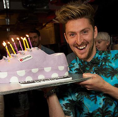 <p>How CUTE is this picture? To celebrate Heny Holland's new collaboration with Superga, his friends and the Superga team gave him this little treat. The giant bespoke lilac polka dot flatform cake (based on the new collection) was a huge hit on Twitter - obvs!</p>