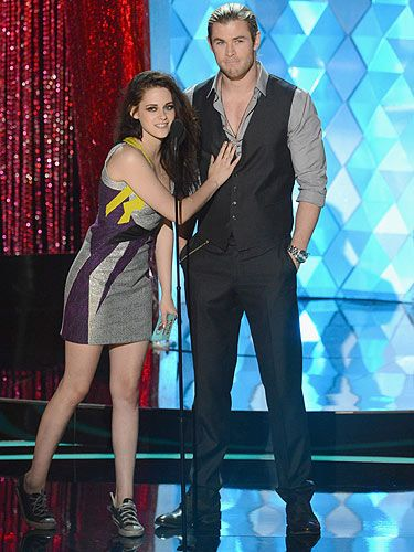 <p>Kristen Stewart and Chris Hemsworth took to the stage at the 2012 MTV Movie Awards. Is it wrong that we're really jealous of Kristen Stewart for having her hands on Chris Hemsworth's chest? Some girls have all the luck...</p>