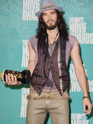 <p>MTV Movie Awards host, Russell Brand didn't shy away from whipping up a frenzy, the comedian dished out some jokes towards Kim Kardashian, Charlie Sheen and John Travolta. We love it!</p>