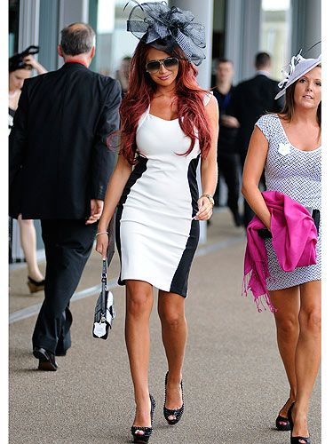 <p>Amy Childs has hit the big time - the 2012 Royal Ascot races. Here she is in a black and white, figure hugging dress from her own collection, which she has teamed with a glowing tan and peep-toe shoes. But is she sticking to the rules? Hmm, we're not so sure!</p>