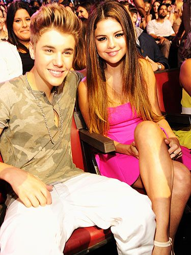 <p>Aww, loves young dream! Justin Bieber took his seat next to his girlfriend Selena Gomez at the 2012 Teen Choice Awards. We hope he was a good boyfriend and brought her a fabulous present for her 20th birthday</p>
