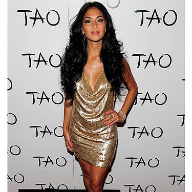 <p>As soon as X Factor judge Nicole Scherzinger made her entrance at her Las Vegas party, it was crystal clear who the birthday girl was! The gorgeous singer was practically head to toe in gold, including gold accessories, but she contrasted the look with outrageous pink nails - LOVE. The drape-like sequinned dress clung to her curves giving the ever desired silhouette. Nicole finished off her look with subtle makeup and natural hair. Overall, the outfit left us all gagging for an invite for what promised to be one hell of a party!</p>