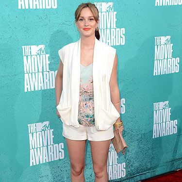 <p>Leighton Meester rocked her new lighter locks on the red carpet at the 2012 MTV Movie Awards. Leighton wore Christian Cota shorts and sleeveless jacket ensemble. She accessorized with Neil Lane jewels, a Jimmy Choo bag, and Brian Atwood heels</p>