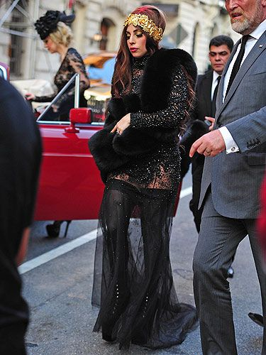 <p>Last night it was the launch of Lady Gaga's 'Fame' Eau de Parfum at the Guggenheim Museum in New York. Of course, Lady Gaga attended – why wouldn't she? Wearing a gothic black studded mesh dress, stockings and platform boots, and for a punch of colour she added a gold headband and a vibrant red lipstick</p>